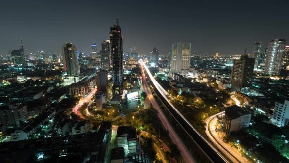 Thumbnail for Shot Of Night Life In The Big City, Lighted Skyscraper, Traffic, Intersection, Bangkok, Thailand