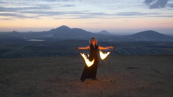 Woman Twirling Burning Torch