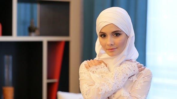Thumbnail for Young Muslim Girl Looking at the Camera