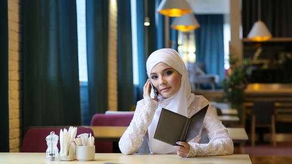 Thumbnail for Young Muslim Girl in Cafe