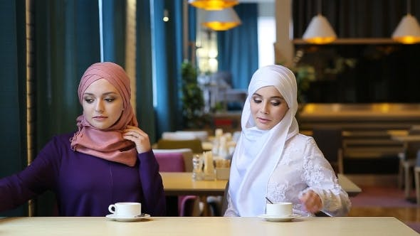 Thumbnail for Two Beautiful Muslim Girl In Cafe