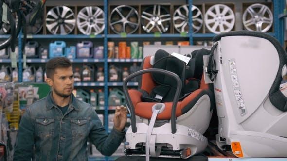 Thumbnail for Man Choose Child Seat in Supermarket
