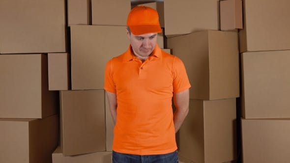 Thumbnail for Courier In Orange Uniform Delivering Damaged Parcel To Customer. Brown Cartons Background. Flaw And