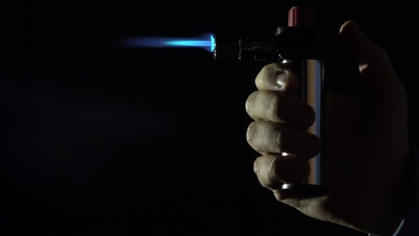 Thumbnail for Gas Burner In Action Against Black Background.   Shot