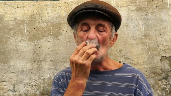 Footage a Man at the Age of Smoking a Cigarette