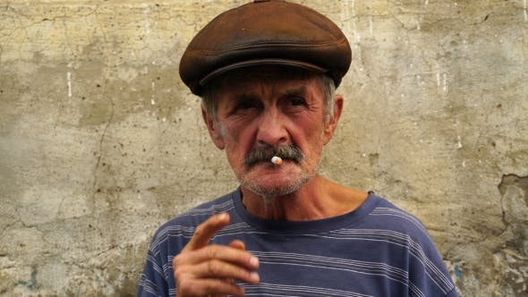Cover Image for Footage a Man At The Age Of Smoking a Cigarette.