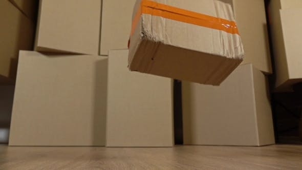 Thumbnail for Damaged Parcel Falling Down On The Floor. Brown Cartons Background. Flaw And Unprofessional Work