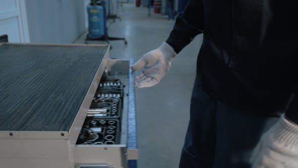 Thumbnail for Mechanic Open Blue Metal Box With Different Tools For Car Repair At Modern Service Station