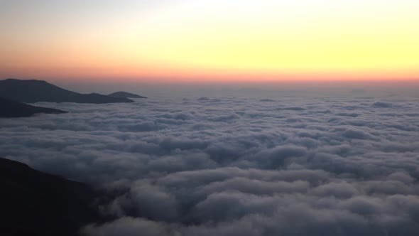 Twilight Before Sunrise Over the Clouds Landscape From Mountain Peak