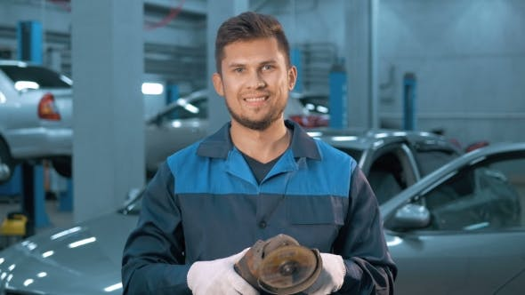 Thumbnail for Portrait of Professional Smiling Car Mechanic Working in Modern Auto Repair Service