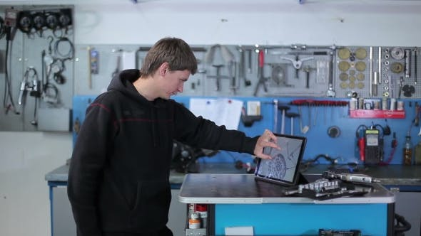 Yacht Specialist Looks At The Scheme On The Tablet