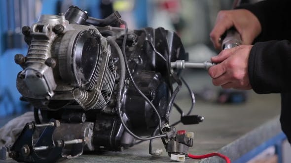 Thumbnail for Mechanic Uses Pneumatic Wrench To Screws Out Bolt