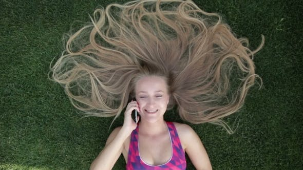 Thumbnail for Woman With Blonde Amazing Long Hair Lying On Grass