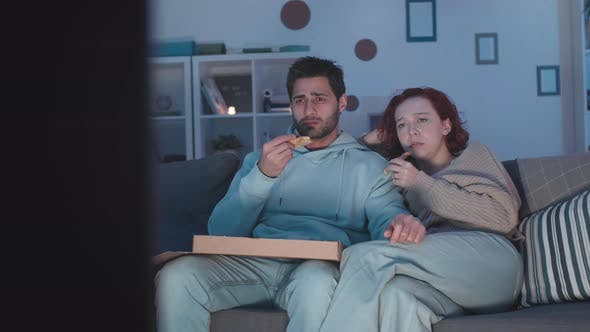 Thumbnail for Couple Cringing and Laughing at Movie