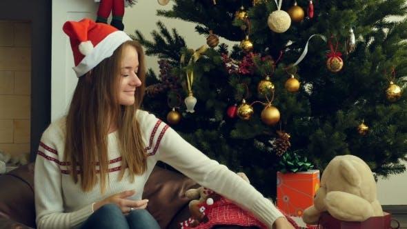 Thumbnail for Young Beautiful Girl Wraps a Christmas Gift