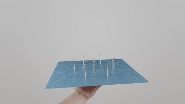 Thumbnail for Man Twists In Hand Windmills Located On Water. Gray Background. Alternative Ecologic Power