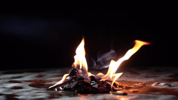 Thumbnail for Super  Shot Of Burning Wooden Chips In The Dark. Small Fire