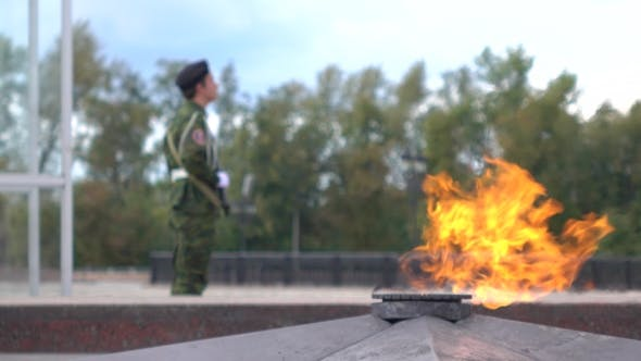 Thumbnail for Unrecognizable Guard With Assault Rifle And World War II Eternal Flame Memorial In Moscow