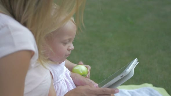 Thumbnail for Baby Takes On The Edge Of The Tablet.