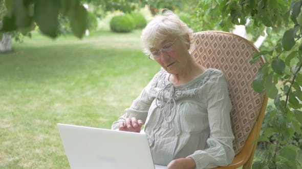Thumbnail for Elderly Woman Talking on a Laptop.