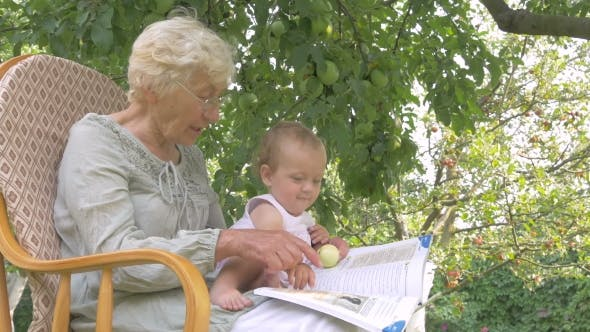 Thumbnail for Grandma Reading a Book To Her Granddaughter.