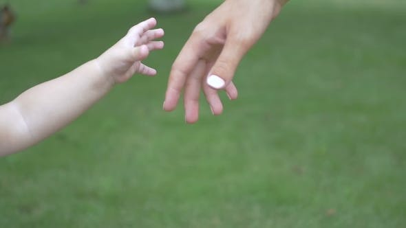 Thumbnail for Girl Holds Her Mother's Hand
