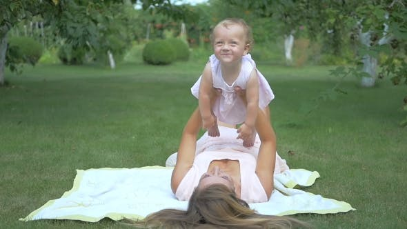 Thumbnail for Mother And Daughter Lying On The Bedspread.