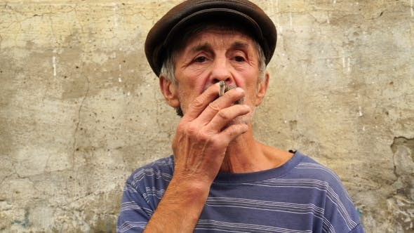 Thumbnail for Footage a Man at the Age of Smoking a Cigarette.