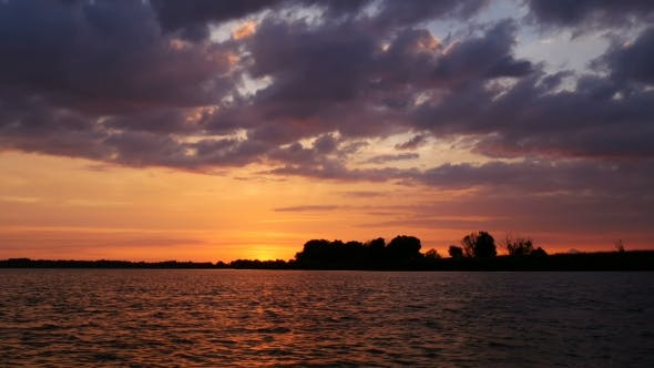 Thumbnail for Colour Sunset Over The River With Sun And Orange Clouds