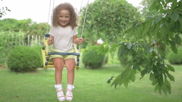 Thumbnail for Little Girl Riding On a Swing In The Park