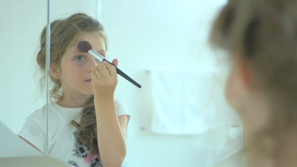 Thumbnail for The Little Girl Powder her Face in the Mirror