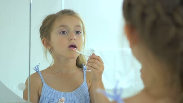 Thumbnail for Girl Paints The Lip Gloss In The Mirror