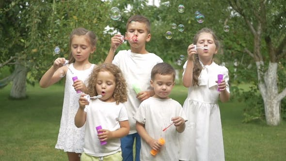 Thumbnail for Little Kids Blows The Bubbles In The Garden