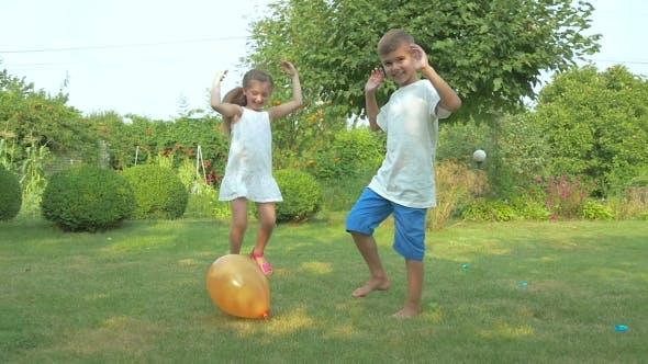 Thumbnail for Children Burst Balloon In The Garden