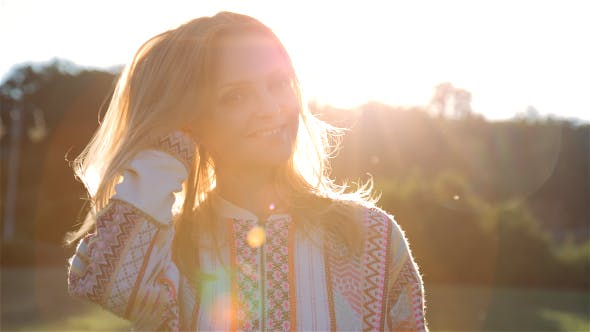 Cover Image for Happy Beautiful Young Woman Smiling at Sunset in City Park 2