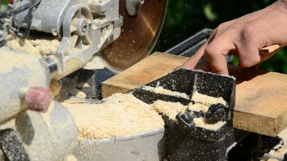 Thumbnail for Man Sawing Wooden Plank With Circular Saw