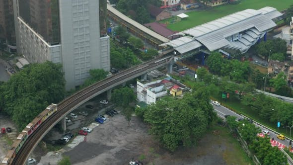 Thumbnail for Bird Eye View Of Railways Across Road Against City Landscape. Kuala Lumpur, Malaysia