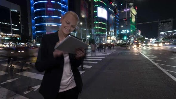 Thumbnail for Woman With Tablet PC In Night Seoul, South Korea