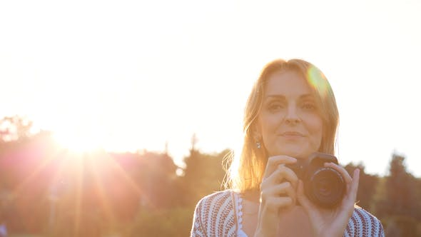 Thumbnail for Beautiful Young Female Photographer Taking Pictures