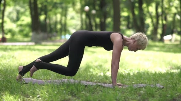 Thumbnail for Woman Practicing Yoga In The Park.