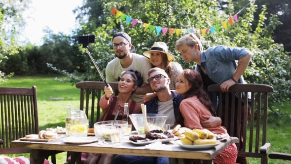 Thumbnail for Friends Taking Selfie At Party In Summer Garden