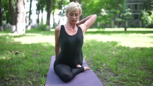 Woman Stretch The Muscles Of The Thigh.