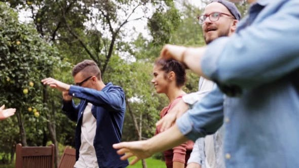 Thumbnail for Happy Friends Dancing At Summer Party In Garden