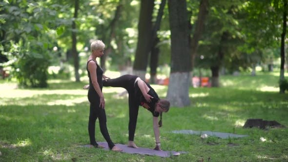 Thumbnail for The Instructor Helps The Girl To Keep The Balance.