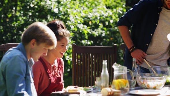 Thumbnail for Friends Gathering For Dinner At Summer Garden