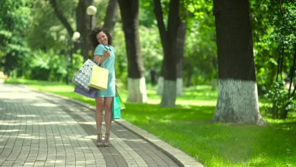Thumbnail for Young Woman Holding Shopping Bags.