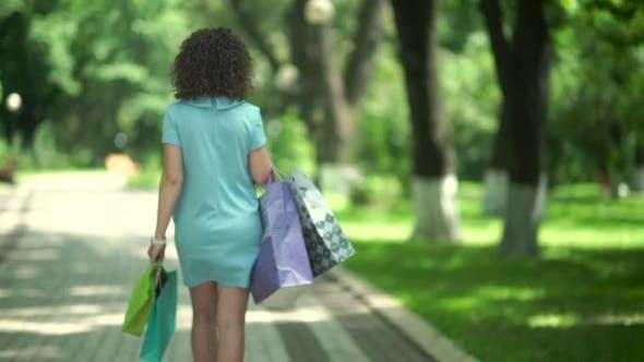 Thumbnail for Brunette Walking Along The Park.