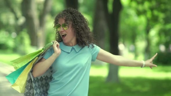 Thumbnail for Curly Girl Dancing And Jumping In The Park.