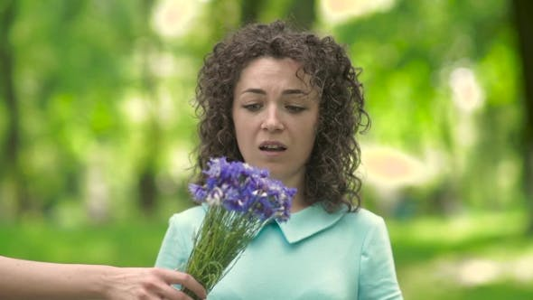 Thumbnail for Beautiful Girl With Curly Hair Sneezes.