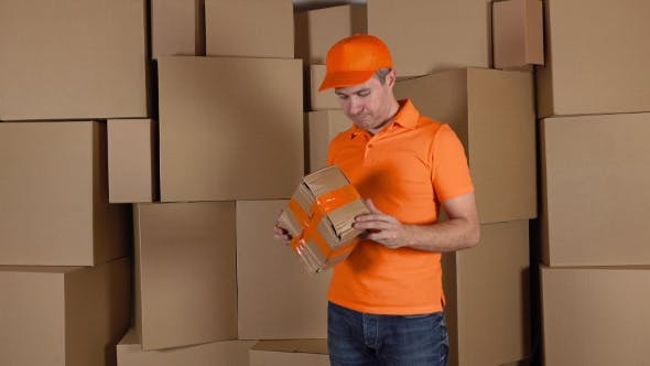 Thumbnail for Delivery Man Delivering Damaged Parcel To Customer